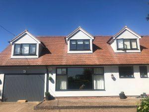 bungalow with on site resprayed upvc windows and garage door in