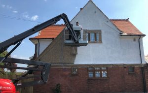 on site respray of external render in white with cherry picker