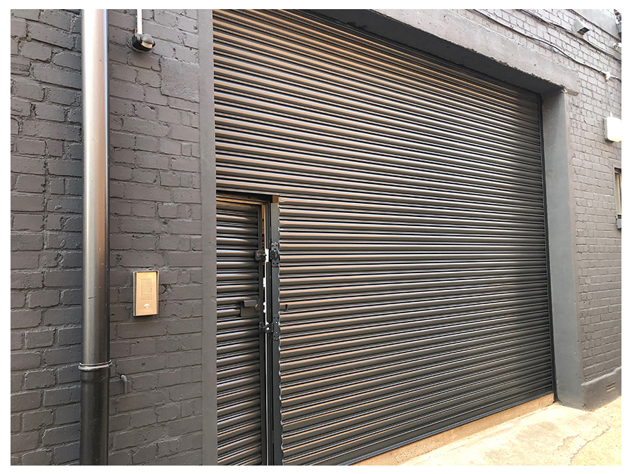 on site respray of roller shutter in black