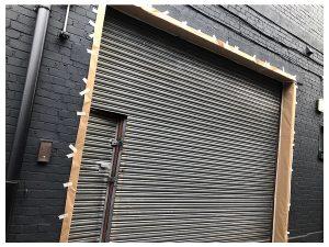 on site respray of roller shutter in black