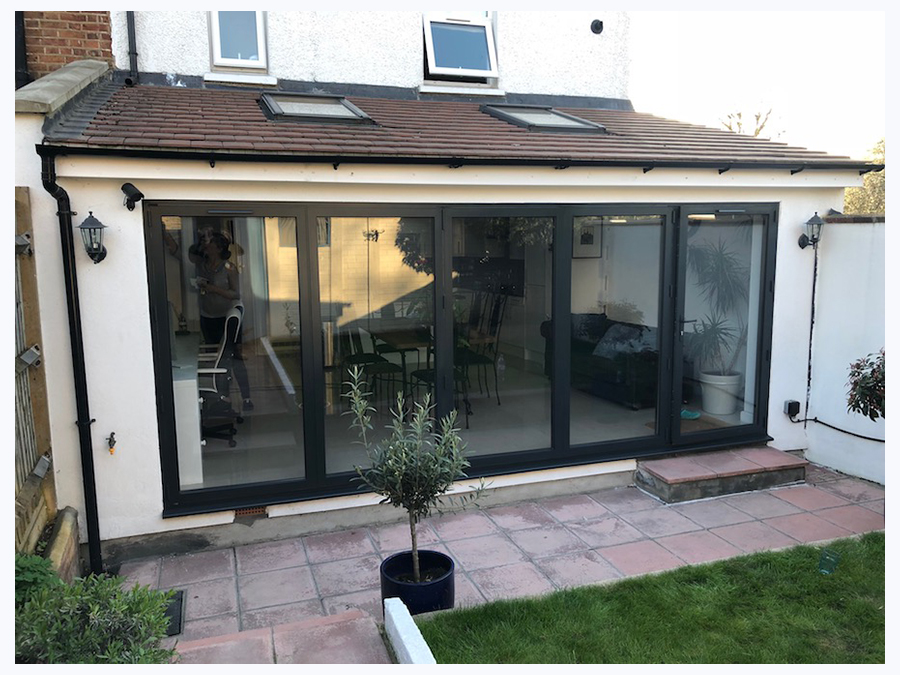 on site resprayed upvc bi fold door in black