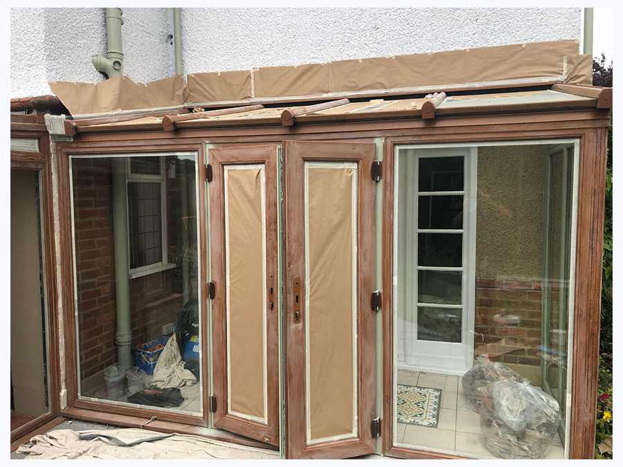 Upvc Conservatory on site Respray in green