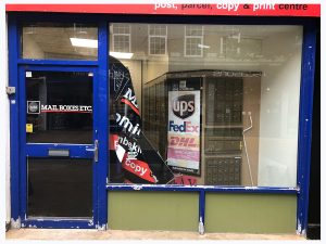 on site respray of mail boxes ltd shop in black
