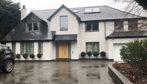 detachted house with new white monocouche spray rendering in london